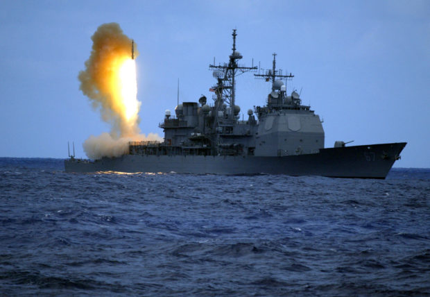 A Standard Missile Three (SM-3) is launched from the guided missile cruiser USS Shiloh (CG 67) during a joint U.S. Missile Defense Agency, U.S. Navy ballistic missile flight test in the Pacific Ocean, June 22, 2006. Two minutes later, the SM-3 intercepted a separating ballistic missile threat target, launched from the Pacific Missile Range Facility in Barking Sands on Kauai, Hawaii. The test was the seventh intercept, in eight program flight tests, by the Aegis Ballistic Missile Defense. The maritime capability is designed to intercept short to medium-range ballistic missile threats in the midcourse phase of flight. Picture taken on June 22, 2006. REUTERS/U.S. Navy/Handout