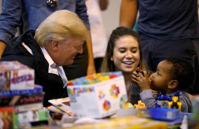 U.S. President Donald Trump visits with survivors of Hurricane Harvey at a relief center in Houston, Texas, U.S., September 2, 2017. REUTERS/Kevin Lamarque - RC18046991C0