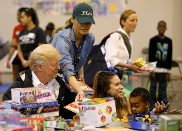 U.S. President Donald Trump and first lady Melania Trump visit with flood survivors of Hurricane Harvey at a relief center in Houston, Texas, U.S., September 2, 2017. REUTERS/Kevin Lamarque - RC121A41C900