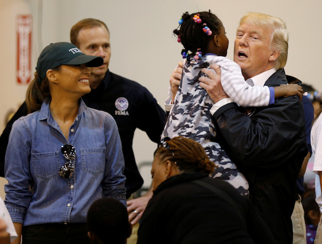 U.S. President Donald Trump lifts up a little girl as he and first lady Melania Trump visit with flood survivors of Hurricane Harvey at a relief center in Houston, Texas, U.S., September 2, 2017. REUTERS/Kevin Lamarque - RC1A53B62D20