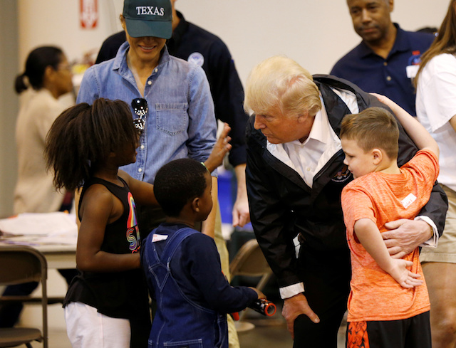 U.S. President Donald Trump and first lady Melania Trump visit with flood survivors of Hurricane Harvey at a relief center in Houston, Texas, U.S., September 2, 2017. REUTERS/Kevin Lamarque - RC187CD92AC0