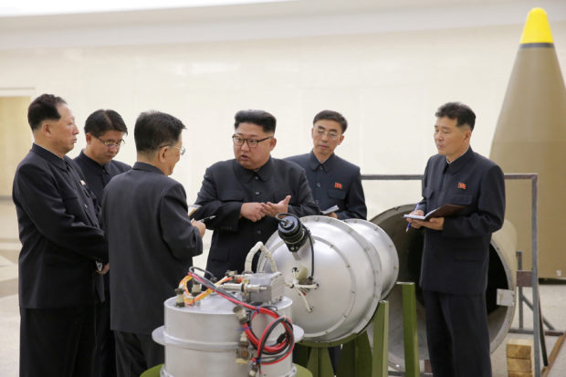 North Korean leader Kim Jong Un provides guidance with Ri Hong Sop (3rd L) and Hong Sung Mu (L) on a nuclear weapons program in this undated photo released by North Korea's Korean Central News Agency (KCNA) in Pyongyang September 3, 2017. KCNA via REUTERS