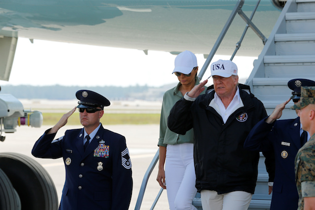 U.S. President Donald Trump returns a salute as he and first lady Melania Trump step off Air Force One prior to receiving a briefing on Hurricane Irma relief efforts in Fort Myers, Florida, U.S., September 14, 2017. REUTERS/Jonathan Ernst - RC124D264BC0