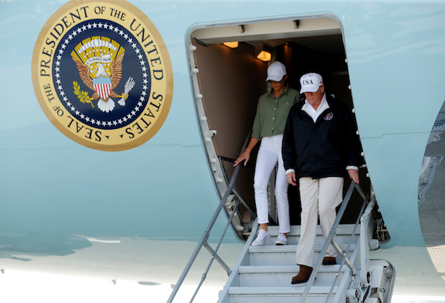 U.S. President Donald Trump and first lady Melania Trump step off Air Force One prior to receiving a briefing on Hurricane Irma relief efforts in Fort Myers, Florida, U.S., September 14, 2017. REUTERS/Jonathan Ernst - RC1A55164DD0