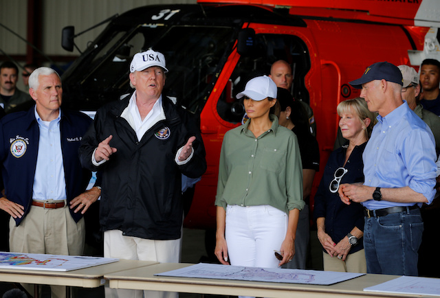 U.S. President Donald Trump, first lady Melania Trump and Vice President Mike Pence (L) receive a briefing with Florida Governor Rick Scott (R) on Hurricane Irma relief efforts in Fort Myers, Florida, U.S., September 14, 2017. REUTERS/Jonathan Ernst - RC1A3E279350