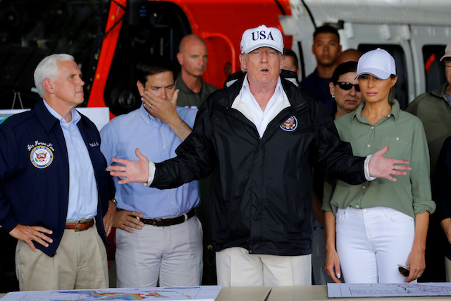 U.S. President Donald Trump speaks between first lady Melania Trump and Vice President Mike Pence (L) and Senator Marco Rubio (R-FL) (2ndL) while receiving a briefing on Hurricane Irma relief efforts in Fort Myers, Florida, U.S., September 14, 2017. REUTERS/Jonathan Ernst - RC13266F9D30