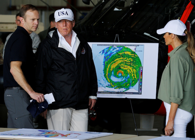 U.S. President Donald Trump receives a briefing on Hurricane Irma relief efforts from Federal Emergency Management Agency (FEMA) Administrator Brock Long (L) as the president arrives to tour storm damage with first lady Melania Trump (R) in Fort Myers, Florida, U.S., September 14, 2017. REUTERS/Jonathan Ernst - RC1D9EC1DAE0