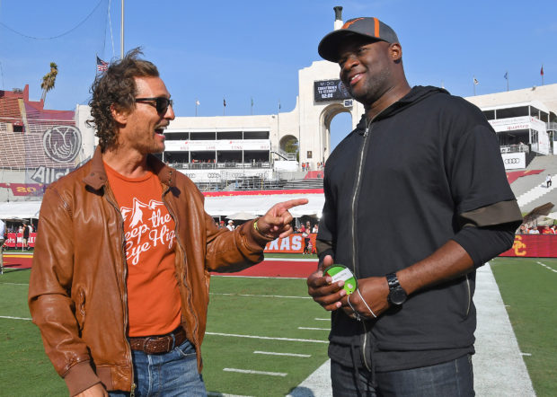 Sep 16, 2017; Los Angeles, CA, USA; Matthew McConaughey (L) and former Texas Longhorns quarterback Vince Young (R) meet on the sidelines before the game against the USC Trojans at Los Angeles Memorial Coliseum. Mandatory Credit: Jayne Kamin-Oncea-USA TODAY Sports - 10285047 via Reuters