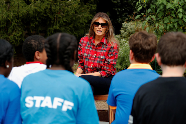 U.S. First Lady Melania Trump talks to students from the Boys and Girls Clubs of Greater Washington before they work together in the White House kitchen garden at the White House in Washington, U.S. September 22, 2017. REUTERS/Jonathan Ernst