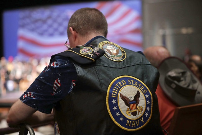 A U.S. Navy veteran participates in an opening prayer during a campaign event of Republican presidential nominee Donald Trump September 6, 2016 in Virginia Beach, Va. (Photo by Alex Wong/Getty Images)