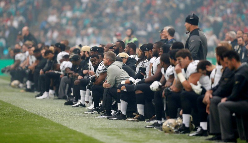 NFL Football - Miami Dolphins vs New Orleans Saints - NFL International Series - Wembley Stadium, London, Britain - October 1, 2017 New Orleans Saints players take the knee before the start of the national anthem Action Images via Reuters/Matthew Childs