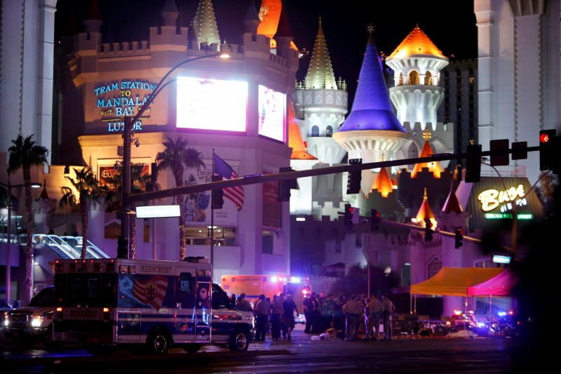 Las Vegas Metro Police and medical workers stage in the intersection of Tropicana Avenue and Las Vegas Boulevard South after a mass shooting at a music festival on the Las Vegas Strip in Las Vegas, Nevada, U.S. October 1, 2017. REUTERS/Las Vegas Sun/Steve Marcus