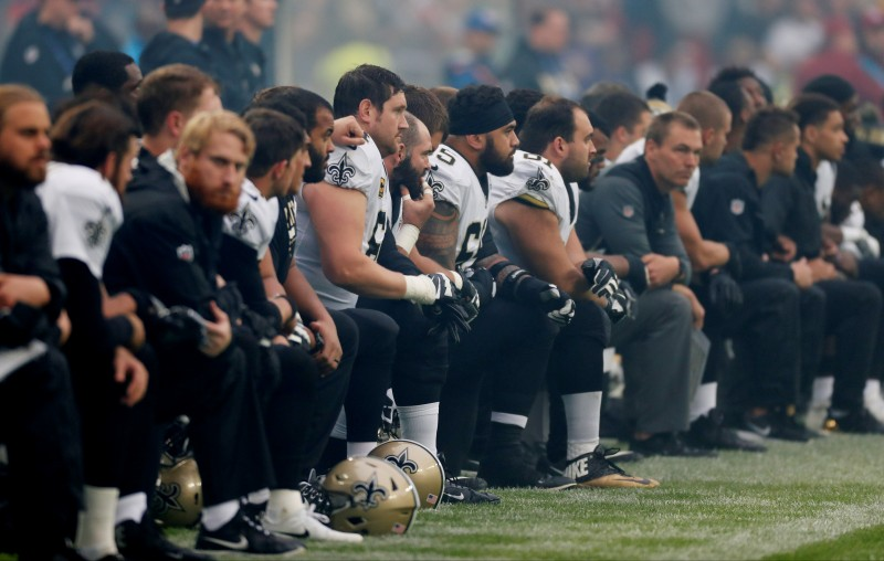 NFL Football - Miami Dolphins vs New Orleans Saints - NFL International Series - Wembley Stadium, London, Britain - October 1, 2017 New Orleans Saints players kneel before the U.S. national anthem before the match Action Images via Reuters/Paul Childs