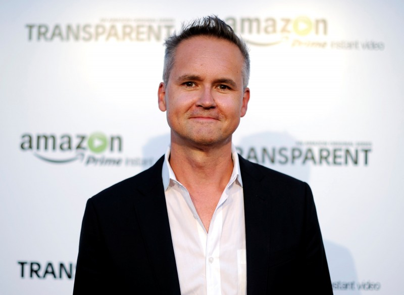 """FILE PHOTO: Roy Price, Director of Amazon Studios, poses during Amazon's premiere screening of the TV series """"Transparent"""" at the Ace Hotel in downtown Los Angeles, California, U.S. on September 15, 2014. REUTERS/Kevork Djansezian/File Photo"""