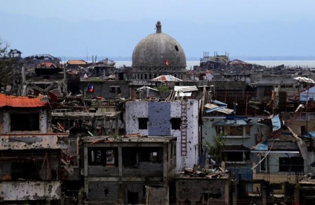 Damaged houses and buildings are seen after government troops cleared the area from pro-Islamic State militant groups inside the war-torn area in Marawi city, southern Philippines October 22, 2017. REUTERS/Romeo Ranoco