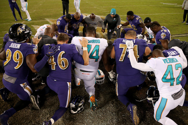 BALTIMORE, MD - OCTOBER 26: Members of the Baltimore Ravens and the Miami Dolphins pray together after the Ravens 40-0 win over the Miami Dolphins at M&T Bank Stadium on October 26, 2017 in Baltimore, Maryland. (Photo by Patrick Smith/Getty Images)