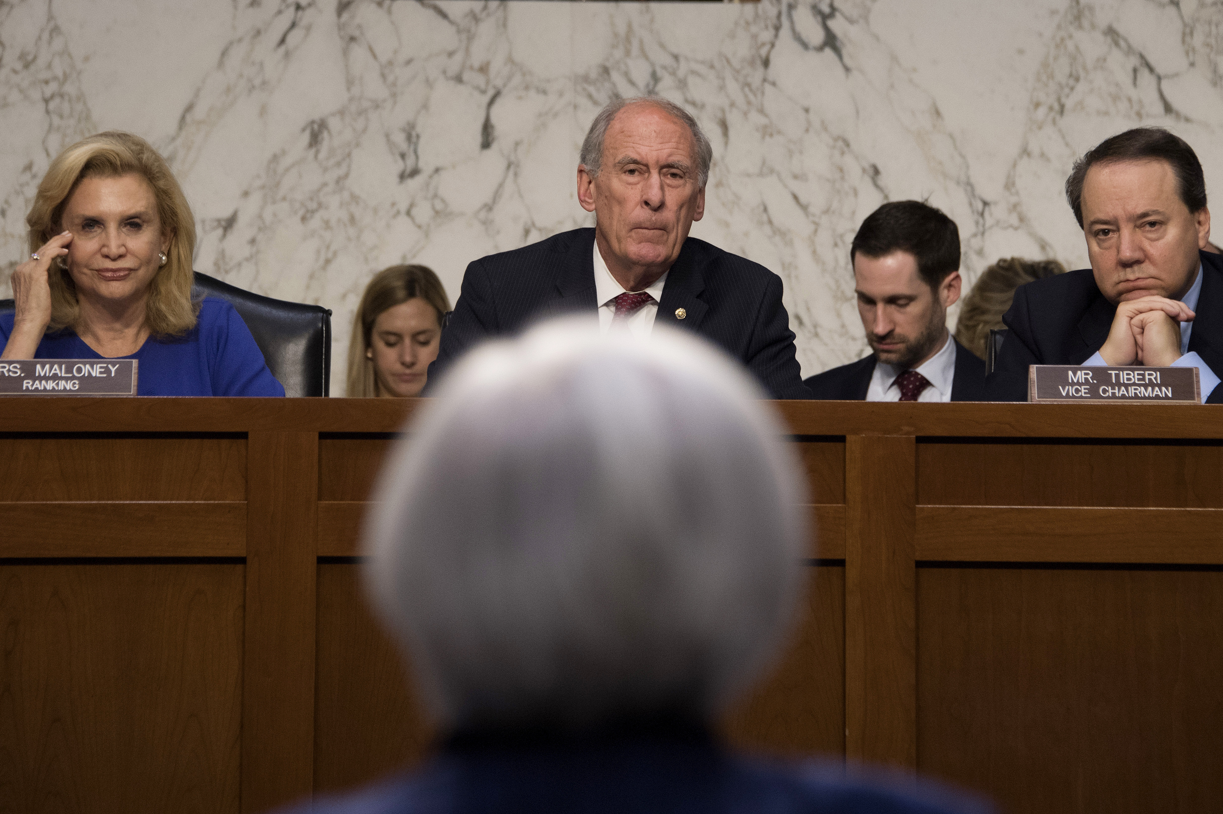 "Congresswoman Carolyn Maloney (L), D-New York; Chairman Dan Coats (C), R-Indiana; and Congressman Pat Tiberi (R), R-Ohio, listen as Federal Reserve Chair Janet Yellen (bottom) testifies before the Joint Economic Committee of Congress on Capitol Hill in Washington, DC, November 17, 2016. Federal Reserve Chair Janet Yellen said Thursday an interest rate increase likely will be appropriate ""relatively soon"" as long as there is further evidence of progress in the economy. JIM WATSON/AFP/Getty Images"