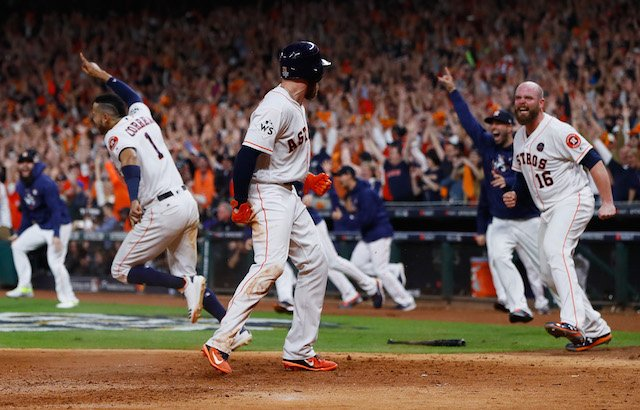 HOUSTON, TX - OCTOBER 30: Derek Fisher #21 of the Houston Astros celebrates with Brian McCann #16 after scoring the winning run during the tenth inning against the Los Angeles Dodgers in game five of the 2017 World Series at Minute Maid Park on October 30, 2017 in Houston, Texas. (Photo by Jamie Squire/Getty Images)