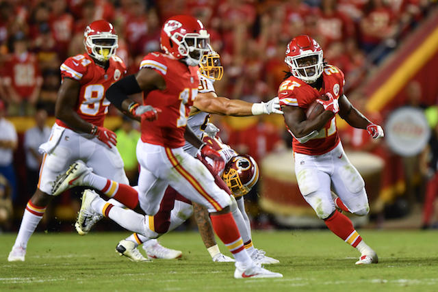 KANSAS CITY, MO - OCTOBER 2: Running back Kareem Hunt #27 of the Kansas City Chiefs rushes through a hole behind the block of Chris Conley during the third quarter of the game against the Washington Redskins at Arrowhead Stadium on October 2, 2017 in Kansas City, Missouri. (Photo by Peter Aiken/Getty Images)