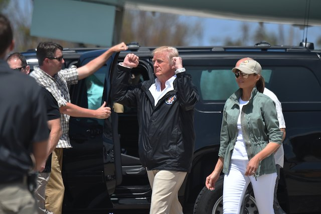 """US President Donald Trump and First Lady Melania Trump arrive at Luis Muñiz Air National Guard Base in Carolina, Puerto Rico on October 3, 2017. President Donald Trump strenuously defended US efforts to bring relief to storm- battered Puerto Rico, even as one island official said Trump was trying to gloss over """"things that are not going well,"""" two weeks after devastating Hurricane Maria left much of the island without electricity, fresh water or sufficient food. / AFP PHOTO / HECTOR RETAMAL (Photo credit should read HECTOR RETAMAL/AFP/Getty Images)"""