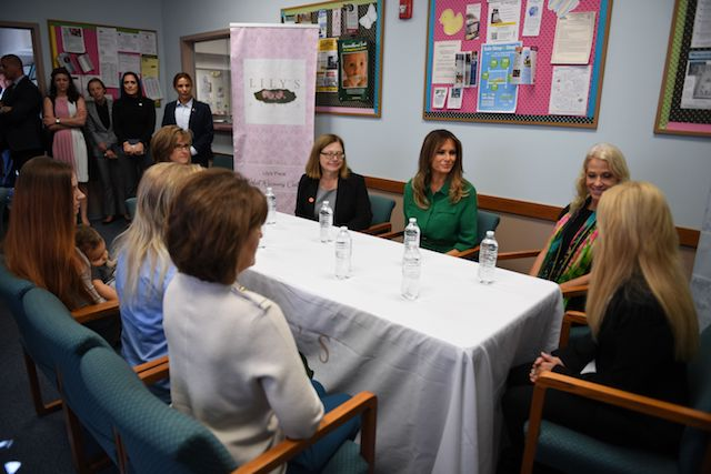 US First Lady Melania Trump (C) and advisor Kellyanne Convay (R) attend a roundtbale at Lily's Place, the US first nonprofit infant recovery center that provides services to parents and families dealing with addiction in Huntington, West Virginia, on October 10, 2017. / AFP PHOTO / JIM WATSON (Photo credit should read JIM WATSON/AFP/Getty Images)