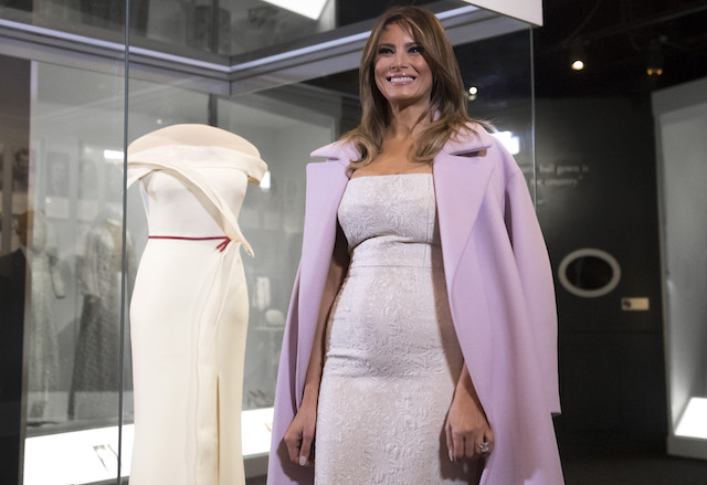 US First Lady Melania Trump stands alongside the gown she wore to the 2017 inaugural balls as she donates the dress to the Smithsonian's First Ladies Collection at the Smithsonian National Museum of American History in Washington, DC, October 20, 2017. / AFP PHOTO / SAUL LOEB (Photo credit should read SAUL LOEB/AFP/Getty Images)