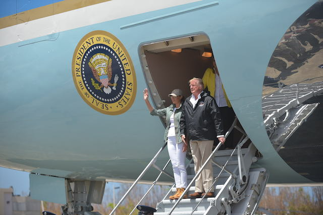 US President Donald Trump and First Lady Melania Trump step off Air Force One upon arrival at Luis Muñiz Air National Guard Base in Carolina, Puerto Rico on October 3, 2017. Nearly two weeks after Hurricane Maria thrashed through the US territory, much of the islands remains short of food and without access to power or drinking water. / AFP PHOTO / MANDEL NGAN (Photo credit should read MANDEL NGAN/AFP/Getty Images)