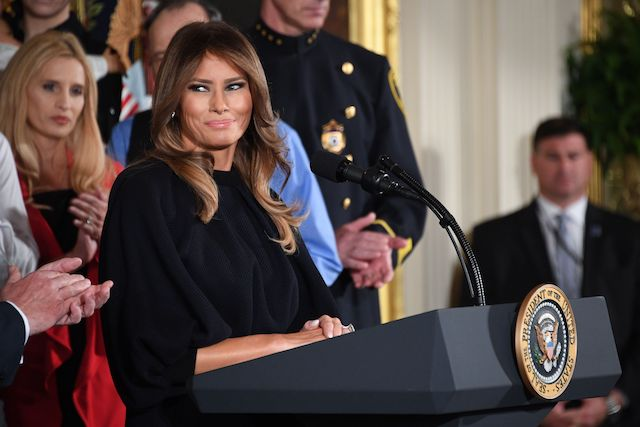 "First Lady Melania Trump speaks before US President Donald Trump delivers remarks on combating drug demand and the opioid crisis on October 26, 2017 in the East Room of the White House in Washington, DC. US President Donald Trump on October 26, 2017 is to declare the opioid crisis a ""nationwide public health emergency,"" stepping up the fight against an epidemic that kills more than 100 Americans every day, officials said. / AFP PHOTO / JIM WATSON (Photo credit should read JIM WATSON/AFP/Getty Images)"
