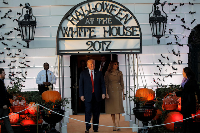 U.S. President Donald Trump and First Lady Melania Trump attend a Halloween event at the South Portico of the White House in Washington, U.S., October 30, 2017. REUTERS/Carlos Barria - RC1691D27D50