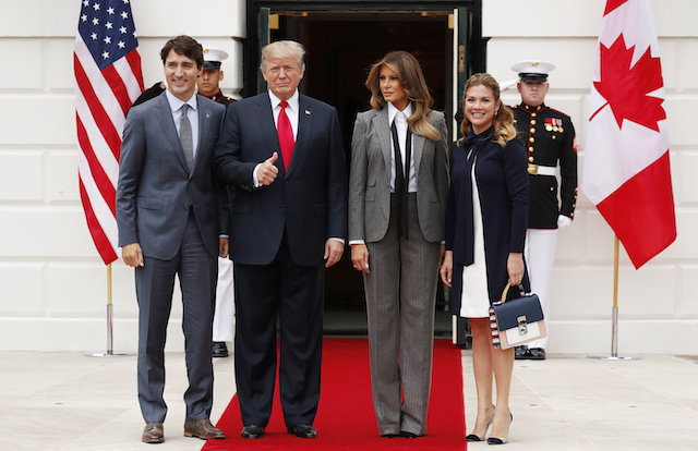 U.S. President Donald Trump gives a thumbs up as he and first lady Melania Trump welcome Canadian Prime Minister Justin Trudeau and Mrs. GrÈgoire Trudeau at the White House in Washington, U.S., October 11 2017. REUTERS/Jonathan Ernst -