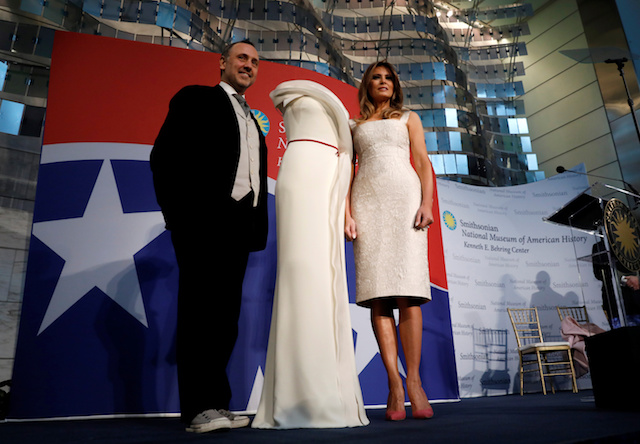 U.S. first lady Melania Trump poses with fashion designer Herve Pierre after presenting her inaugural gown to the Smithsonian's National Museum of American History in Washington, U.S., October 20, 2017. REUTERS/Kevin Lamarque -