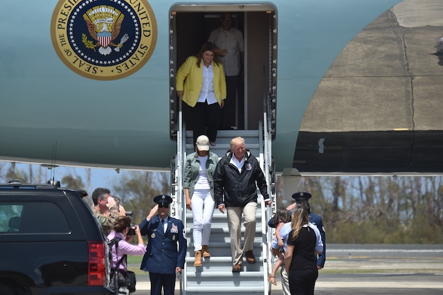 US President Donald Trump and First Lady Melania Trump step off Air Force One upon arrival at Luis Muñiz Air National Guard Base in Carolina, Puerto Rico on October 3, 2017. Nearly two weeks after Hurricane Maria thrashed through the US territory, much of the islands remains short of food and without access to power or drinking water. / AFP PHOTO / HECTOR RETAMAL (Photo credit should read HECTOR RETAMAL/AFP/Getty Images)