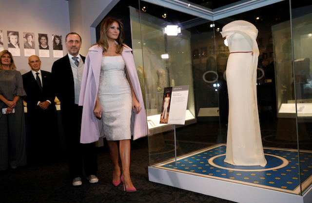 U.S. first lady Melania Trump and fashion designer Herve Pierre view the display of her inaugural gown after presenting it to the Smithsonian's National Museum of American History in Washington, U.S., October 20, 2017. REUTERS/Kevin Lamarque
