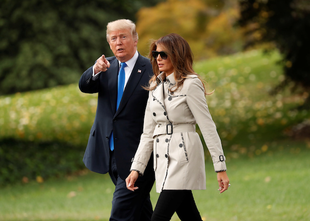 First Lady Melania Trump and U.S. President Donald Trump depart the White House in Washington, U.S., October 13, 2017. REUTERS/Kevin Lamarque