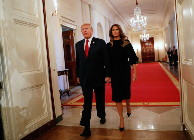 U.S. President Donald Trump arrives with First Lady Melania Trump before he speaks about administration plans to combat the nation's opioid crisis in the East Room of the White House in Washington, U.S., October 26, 2017. REUTERS/Kevin Lamarque