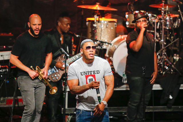 Rapper Nelly performs with the hip hop group The Roots at the Live Nation Celebration National Concert Day at Irving Plaza on May 1, 2017 in New York. / AFP PHOTO / EDUARDO MUNOZ ALVAREZ (Photo credit should read EDUARDO MUNOZ ALVAREZ/AFP/Getty Images)