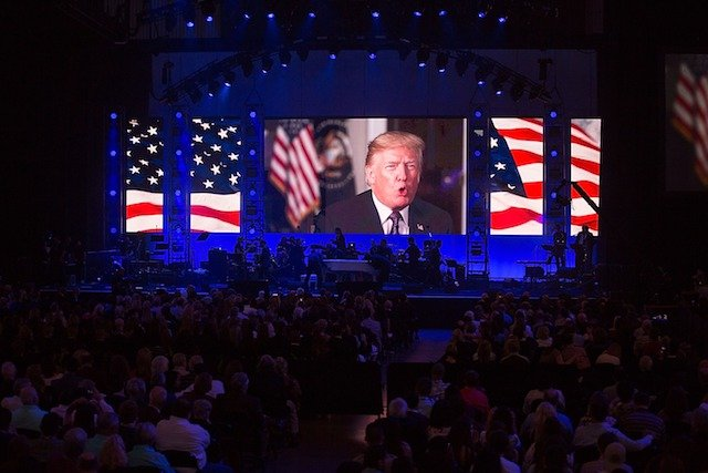 COLLEGE STATION, TX - OCTOBER 21: President Donald Trump addresses the audience during the 'Deep from the Heart: The One America Appeal Concert' at Reed Arena on the campus of Texas A&M University on October 21, 2017 in College Station, Texas. (Photo by Rick Kern/Getty Images for Ford Motor Company)