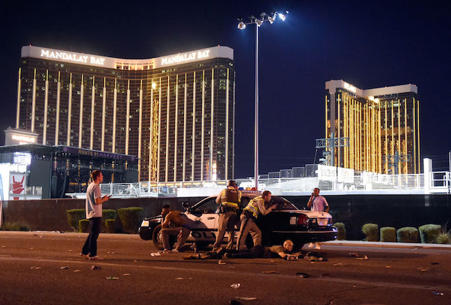 Las Vegas police stand guard along the streets outside the Route 91 Harvest Country music festival grounds of the Route 91 Harvest on October 1, 2017 in Las Vegas. (Photo by David Becker/Getty Images)
