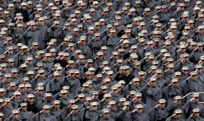 Attending cadets salute from the upper deck of Michie Stadium during graduation ceremonies at the United States Military Academy at West Point, New York, May 25, 2013. REUTERS/Mike Segar