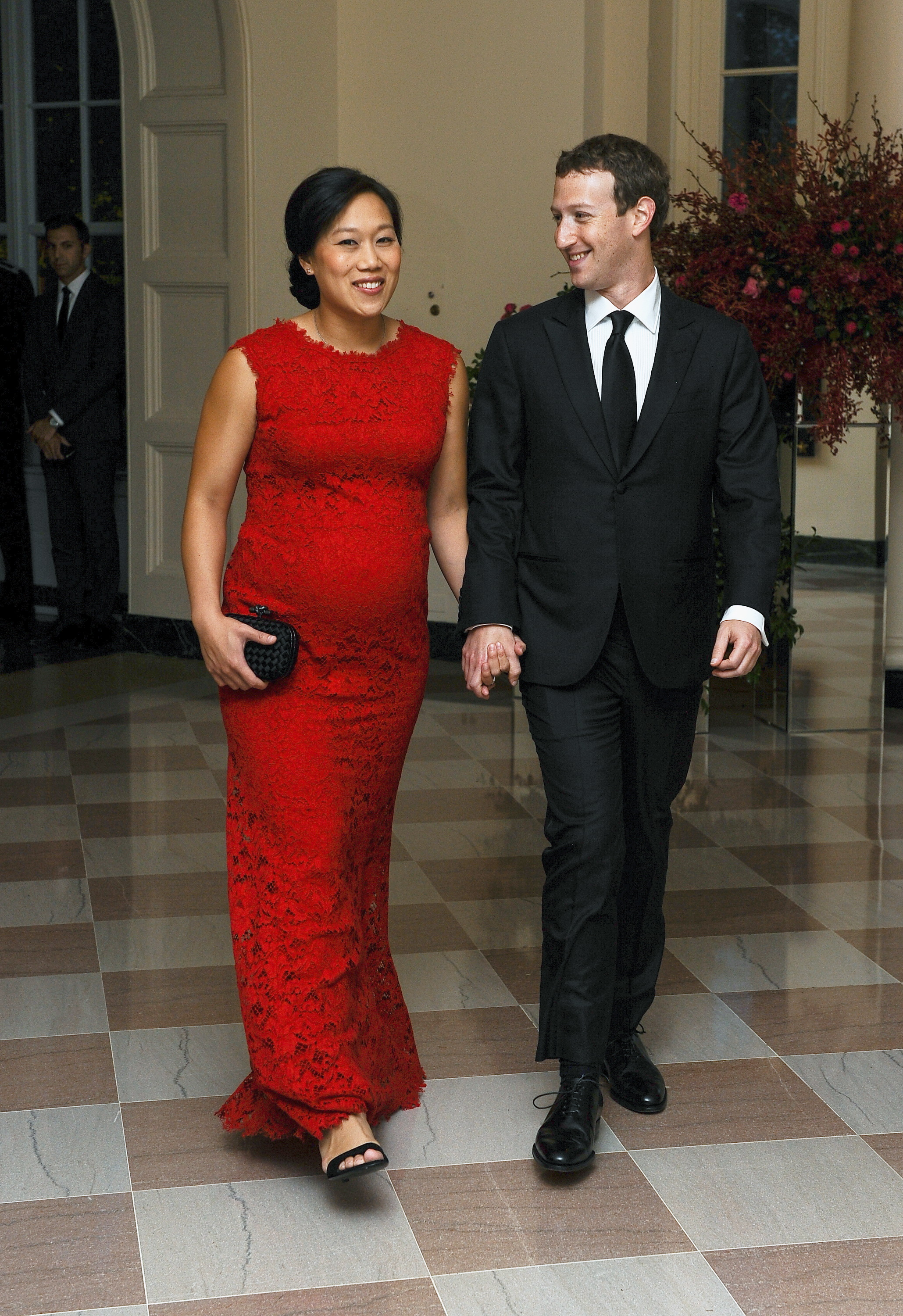 Mark Zuckerberg, Chairman and CEO of Facebook, and his wife Priscilla Chan arrive for the official State dinner for Chinese President Xi Jinping and his wife Peng Liyuan at the White House in Washington, September 25, 2015. REUTERS/Mary F. Calvert