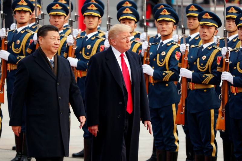 U.S. President Donald Trump takes part in a welcoming ceremony with China's President Xi Jinping in Beijing, China, November 9, 2017. REUTERS/Jonathan Ernst