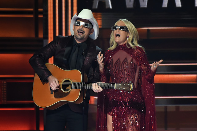 NASHVILLE, TN - NOVEMBER 08: Co-hosts Brad Paisley and Carrie Underwood speak onstage at the 51st annual CMA Awards at the Bridgestone Arena on November 8, 2017 in Nashville, Tennessee. (Photo by Rick Diamond/Getty Images)