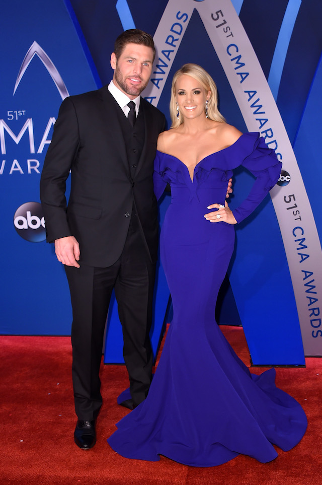 NASHVILLE, TN - NOVEMBER 08: NHL player Mike Fisher and singer-songwriter Carrie Underwood attend the 51st annual CMA Awards at the Bridgestone Arena on November 8, 2017 in Nashville, Tennessee. (Photo by Michael Loccisano/Getty Images)
