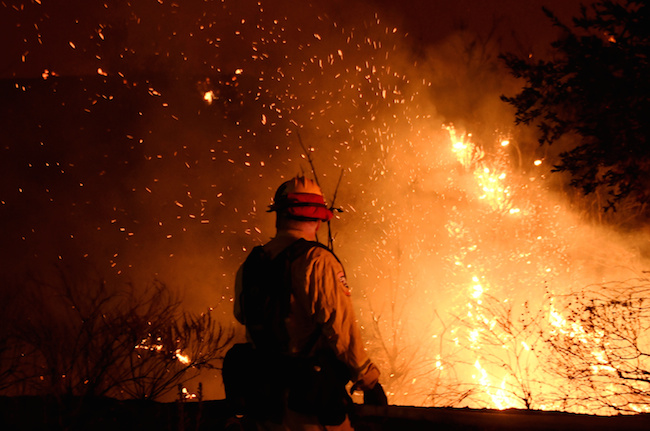 Firefighters battle the so-called Sand Fire in the Angeles National Forest near Los Angeles, July 24, 2016. REUTERS/Gene Blevins