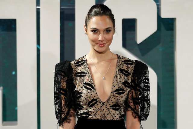 Actor Gal Gadot poses for photographers at the Justice League photocall, at The College, in London, Britain November 4, 2017. REUTERS/ Peter Nicholls - RC15CDF7EE90