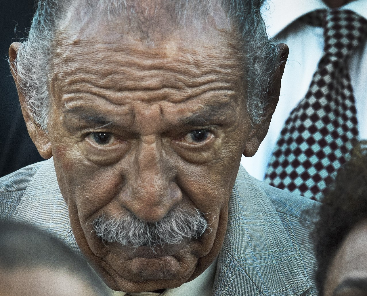 US Rep John Conyers (D-MI) listens as US House of Representatives Minority Leader Nancy Pelosi speaks during a press conference about the Iran nuclear deal on Capitol Hill in Washington on September 8, 2015. PAUL J. RICHARDS/AFP/Getty Images