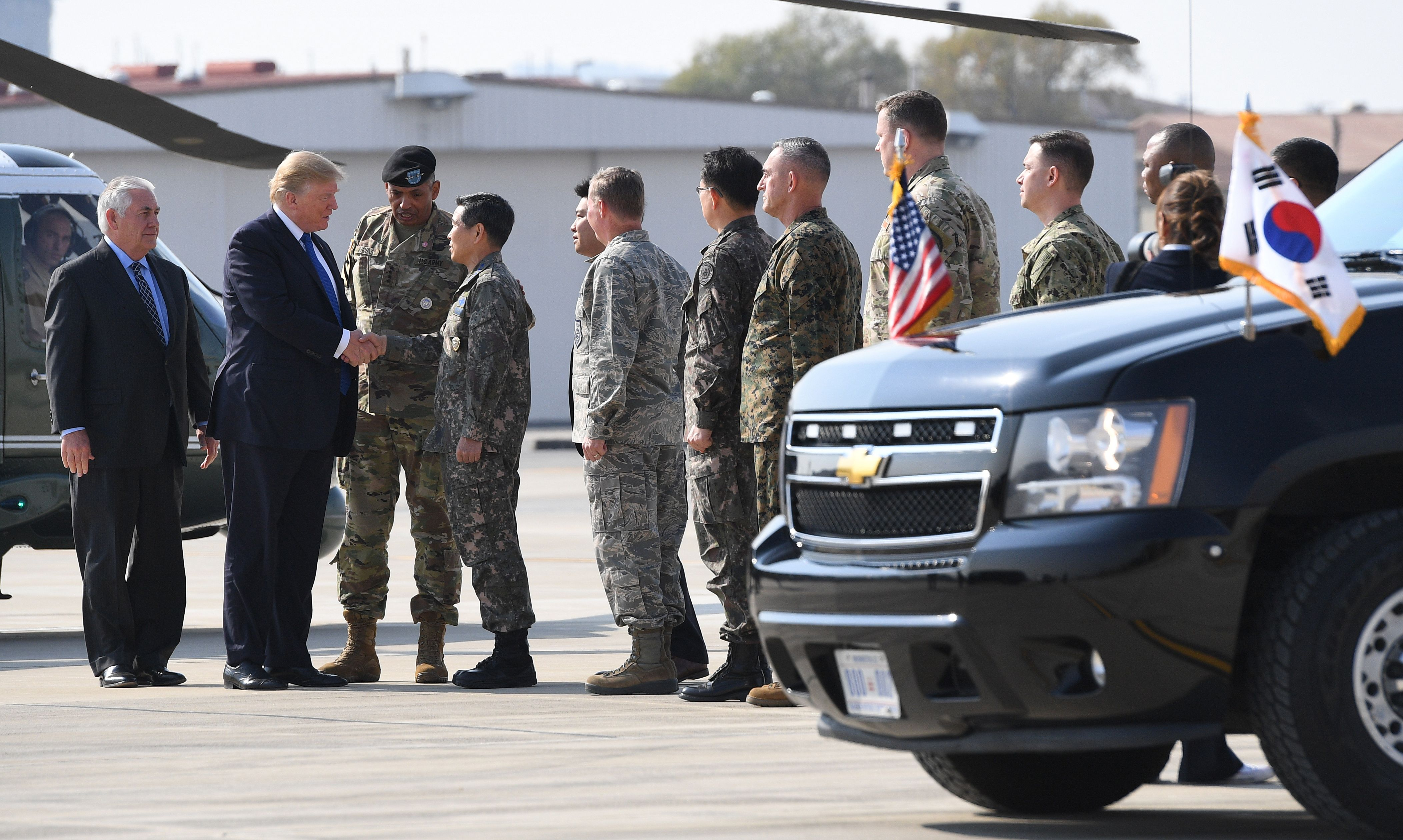 US President Donald Trump (2nd-L) greets military personnel upon arriving at Camp Humphreys in Pyeongtaek, south of Seoul on November 7, 2017. Trump's marathon Asia tour moves to South Korea, another key ally in the struggle with nuclear-armed North Korea, but one with deep reservations about the US president's strategy for dealing with the crisis JIM WATSON/AFP/Getty Images