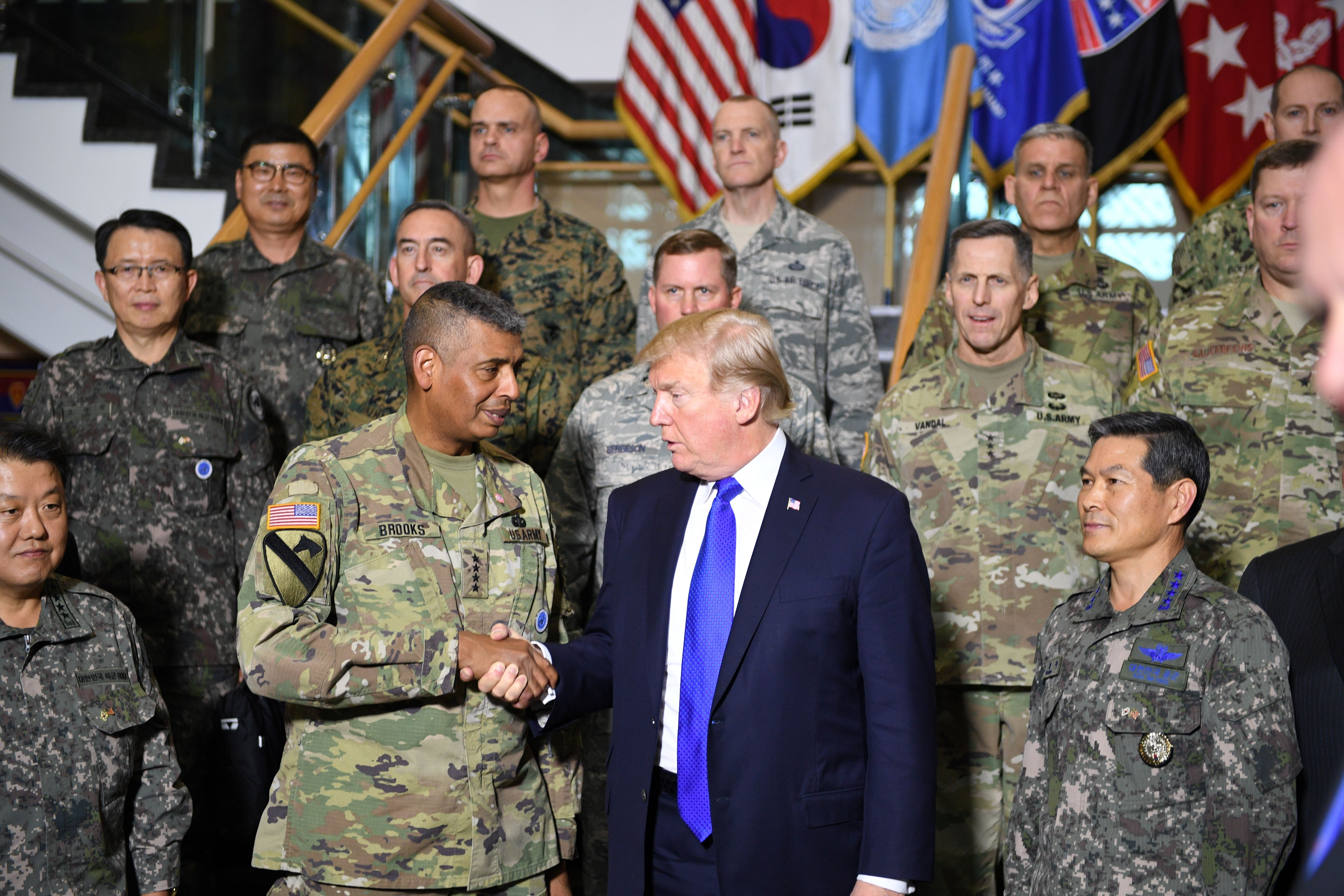 US President Donald Trump shakes hands with US Forces Korea Commander General Vincent Brooks at the 8th Army Operational Command Centre at Camp Humphreys in Pyeongtaek, south of Seoul on November 7, 2017. Trump's marathon Asia tour moves to South Korea, another key ally in the struggle with nuclear-armed North Korea, but one with deep reservations about the US president's strategy for dealing with the crisis. JIM WATSON/AFP/Getty Images