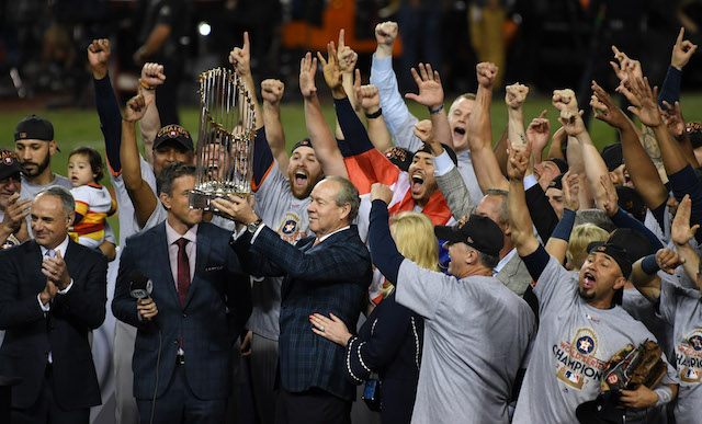 Nov 1, 2017; Los Angeles, CA, USA; MLB commissioner Rob Manfred presents Houston Astros owner Jim Crane with the Commissioner's Trophy after the Houston Astros defeated the Los Angeles Dodgers in game seven to win the 2017 World Series at Dodger Stadium. Mandatory Credit: Richard Mackson-USA TODAY Sports Reuters