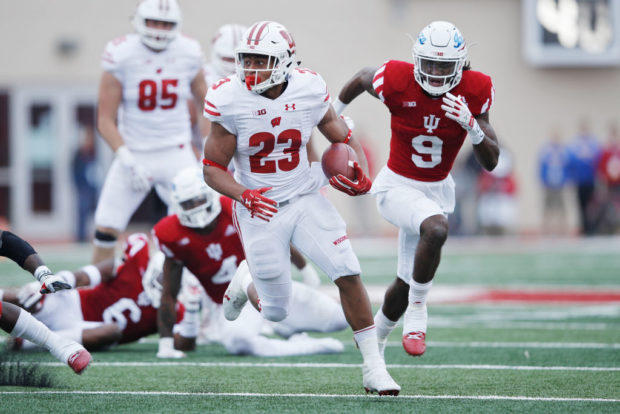 BLOOMINGTON, IN - NOVEMBER 04: Jonathan Taylor #23 of the Wisconsin Badgers runs for a 32-yard touchdown in the third quarter of a game against the Indiana Hoosiers at Memorial Stadium on November 4, 2017 in Bloomington, Indiana. Wisconsin defeated Indiana 45-17. (Photo by Joe Robbins/Getty Images)